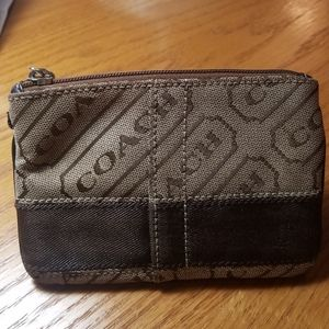Coach zipper pouch.